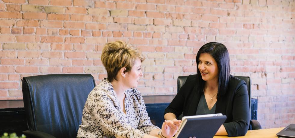 Women discussing digital